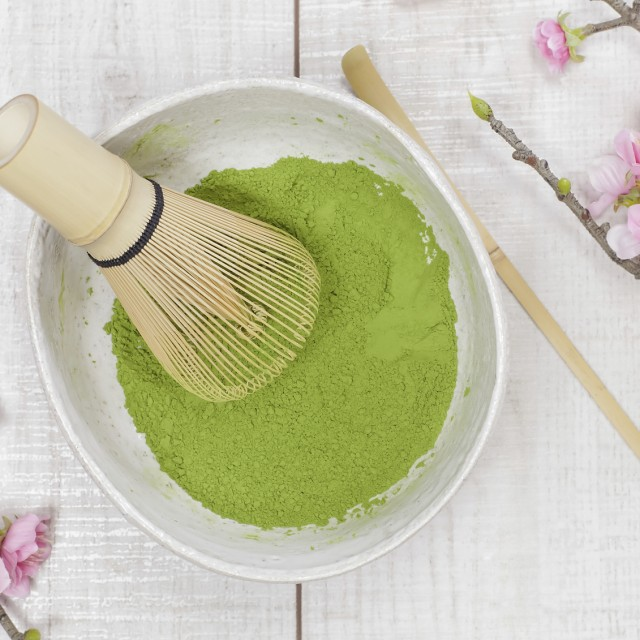 Still life with green tea powder and bamboo whisk. Japanese Tea Ceremony: Preparation of powdered green tea